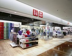 Fashion retailer UNIQLO has a nice wide storefront with a nice decompression zone - note the flooring change and the bright colours against the white background inside. Most of the shelving is kept to a low level, which allows customers to see further into the store. The wall of coloured shirts almost acts as an artwork to add variation to the otherwise white background. Clean and clever.