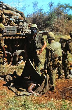 05 June 1967, Con Thien, South Vietnam. A tank is piled high with American dead as men of the 9th Marines remove the bodies of their fallen comrades from the battlefield.