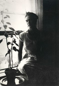 Frida Kahlo by the window, 1932.