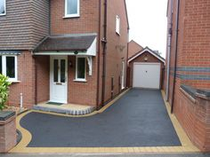 Birmingham based Oakleaf Driveways Limited have over 50 years experience and are specialist installers of black tarmac drives and driveways. Tarmac Drives, Asphalt Driveway, Driveway Design, Driveways, Birmingham, Outdoor Decor, Black, Sidewalks, Black People