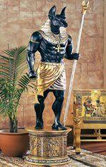 ANÚBISO - deus com cabeça de chacal nasceu da união de Osíris e Nephthys. Foi ele quem criou a primeira múmia, ao preparar o corpo do pai assassinado. Tem papel importante na passagem para o mundo dos mortos.