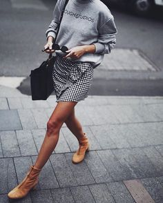 Jumper, check skirt & tan boots. (andicsinger)