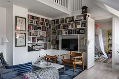 Attic living space filled with books in a Stockholm penthouse