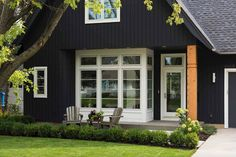 Vertical siding, extravant greenery, and dark colors are just a few of the exterior home trends and design elements that you can expect to see this year. House Paint Exterior, Exterior Paint Colors, Exterior House Colors, Exterior Design, Minneapolis, Beautiful Modern Homes, Beautiful Interiors, Farmhouse Paint Colors, Farm House Colors