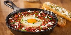 Crossed Cuisines Shakshuka with Duck Sausage and Duck Fat Toast | 2016 Recipe Contest Grand Prize Winner, Merry Graham, Newhall, CA. A trio of duck products gives a twist to this shakshuka -- a spicy, traditional dish from Israel made of eggs poached in a tomato-red pepper sauce.