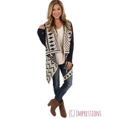 🎊 FINAL 2016 SALE‼️Cozy Aztec cardigan This ivory, navy, and red cardigan is great for every season! Pair with jeans or shorts for day or night! Worn once. Still has strings to hang up when laundering. 24 inch long sleeves. Super cozy material. Impressions Sweaters Cardigans