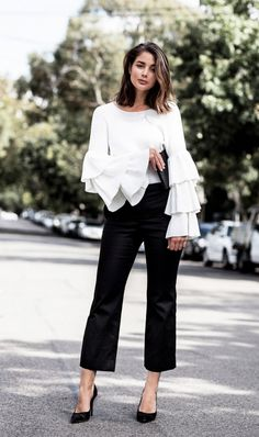 Style Tip: Pair tiered ruffled sleeves with a pair of smart trousers and pumps.