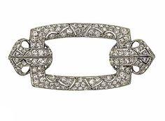 A buckle brooch of pierced geometric design, set throughout with brilliant-cut diamonds, 4.5cm wide