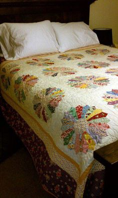 ok so this dresden plate quilt was made by one of the guys at the shop. Jake made it for his wife for Christmas!