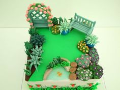 A Garden Cake Ordered by a Husband for his wife's special birthday, Based on her garden. All edible and my first time with piping gel! (the Pond)