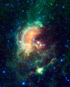 This is the Tadpole Nebula. You can see the hot young stars in the center, which are yellow and look like tadpoles. The faint green line near the top is actually a streaking satellite (one of ours) :)