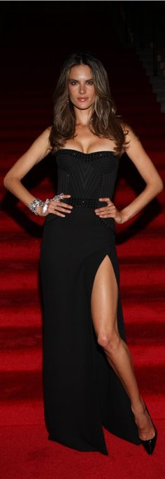 Alessandra Ambrosio in a black gown with a leg slit. This dress is very flattering and a great red carpet look. I really love the beading detail on the top.
