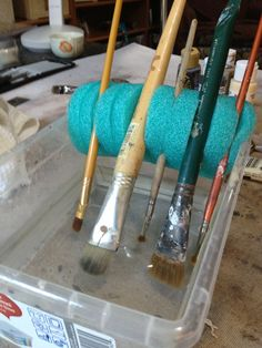 Slit a piece of Pool Noodle to fit on a water bin. Cut slits with a craft knife to hold your brushes off the bottom while you work. No more bent bristles!