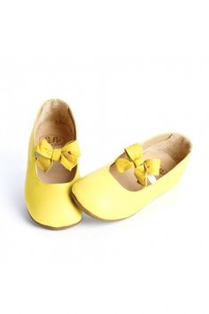 Leather Mary Janes saturated in a brilliant shade of yellow. Big bows across the front add a fancy touch. By Pepe.
