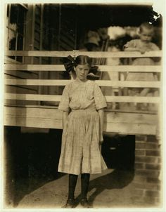 Lilly OSullivan, a frail 13 year old girl working in the Drayton Mills, Spartenberg [sic], S.C. Been working four years, weaving, spinning, etc. Ran from 4 to 6 looms. Gets $3 a week. Location: Spartanburg, South Carolina.