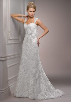 <3 this one :) Gown features beading, lace, corset bodice, floral belt and detachable cap sleeves.