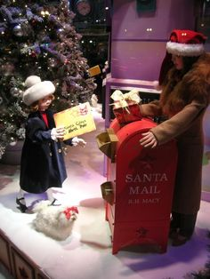 children's mannequins and dog mannequin in a holiday window display are too cute