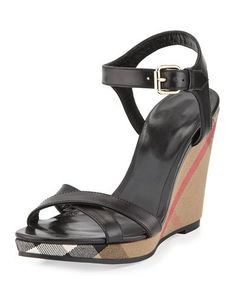 """Burberry sandal with calf leather upper. 3"""" check-canvas wedge heel. Crisscross toe straps. Adjustable ankle strap. Leather lining. Rubber outsole. """"Rastrickson"""" is made in Italy."""