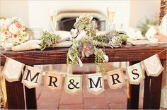 Banner or name plaques on the front of the table, since that will be facing all the guests.