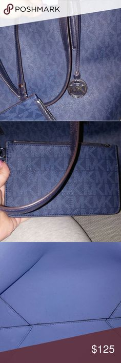 Michael kors tote and wristlet Hello ladies I'm selling my authentic Michael kors two tone blue tote with matching wristlet. This a huge tote could be used as a beach bag or school/work bag. I used this for college and carried four books and my laptop comfortably. No trades any questions please ask. Michael Kors Bags Totes