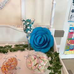 Our decorative flowers in use! #paper #flowers #paperflowers #blue #christening #decorations #wallflowers #giant #sweetcart #sweets #unique #handmade #manchester #foreverpaperflowers