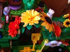Lego Duplo plant decorated with flowers.