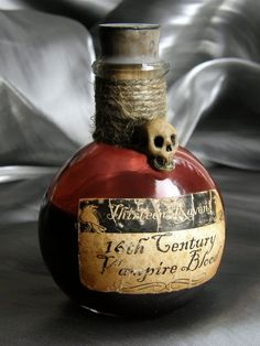 Inspiration: Apothecary jars with vintage style labels wound with burlap and Polymer Skull for Halloween Party Decorations.