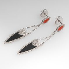 These fantastic Gabriel & Co. dangle earrings are crafted in the Deco style and feature black onyx and carnelian accented with a total of 138 round brilliant diamonds. The earrings are crafted of 14k white gold. They are each marked