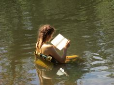 I do reading right. It was freaking hot but I wanted to read so I compromised. Chair in river. Fab.