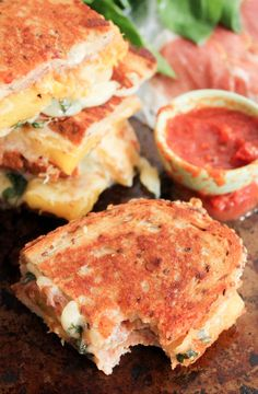 The Ultimate Hawaiian Grilled Cheese. Grilled Cheese with prosciutto, grilled pineapple, basil and spicy tomato sauce for dipping. EPIC.