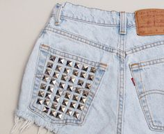 DIT stud pockets. could go well with the chucks...just a design at the top of the pockets. @Brittany Metz for hip hop maybe??