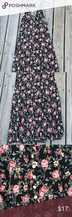 Roxy rose floral pattern long button down dress Roxy long floral pattern dress. Peachy pink roses all over dress, dress is black, has green vines, And lace trim around armpits and chest. Has a bow that ties in back to make more form fitting. Has buttons all the way down the front. The bottom back has a more rounded off cut. The front is more square like as shown in pics. This is a tank top style dress. Long pretty much at ankles. Beautiful dress great for summer and spring, wear to…