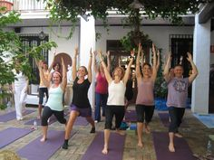 Group of yogis all in warrior one - great energy