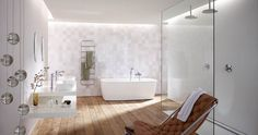 Hansgrohe bathroom idea.  I love the floor boards, the open and airy feel of the shower and the colours. Would need more storage though.