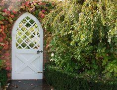 What a whimsical garden door.