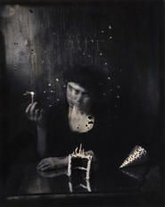 """Lauren E. Simonutti, Sixth year birthday - me, myself and eye. I blew out the match, these candles were never lit, 2011 From the 8 Rooms 7 Mirrors 6 Clocks 2 Minds and 199 Panes of Glass series 5 x 4"""" toned gelatin silver contact print"""