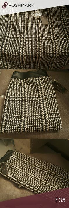 BCBG gorgeous skirt with leather around the waist Beautiful lined skirt perfect for the winter BCBG brand size large fits right below the knee.. BCBG Skirts Pencil