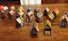 Tiny house ornaments! In the spirit of a handmade holiday, many Folk School decorations are created from Folk School Catalogs of the past. With the arrival of our new Catalog, we encourage you to re-purpose your 2014 Folk School catalog to make crafty and inexpensive holiday decorations with your family and friends.