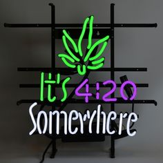 It's 4:20 Somewhere Neon Sign featuring multi-colored, hand blown neon tubing. The glass tubes are supported by a black finished metal grid which can be hung against a wall or window. It can even sit