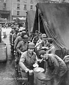 June the 1st 1944. 6 pm. Last hot meal ashore...The American Red Cross takes collects the belts and neckties from the youngest fellas. These guys are scared, and it shows. The strongest drink they've ever had? Probably a milkshake!
