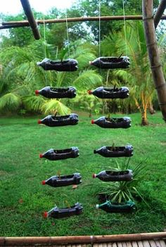 recycled plastic bottle hanging planters | recycling plastic soda bottles as hanging planters