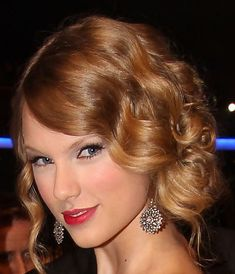 Hate her hair color...love the retro updo. Def an option.