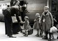 A policeman makes sure young evacuees are on the correct train out of London for evacuation, 1940. (Press Association)