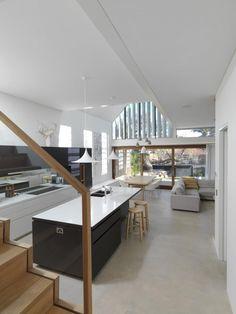 Contrasting dark coloured kitchen sink on light island work top to match dark island unit Waverly House - Anderson Architecture