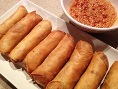 hmong eggrolls - Yum! To save time and energy I use a bag of coleslaw mix instead of cutting up cabbage and carrots.  I also use spring roll skins  (there are more more the money) and they cook up the same.