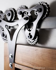 Double Triangle barn door hardware's complex and rhythmic movement as it rolls along the track is contrasted by its sleek design.  http://rusticahardware.com/double-triangle-barn-door-hardware/