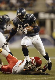 Runningback Kerry Carter of the Seattle Seahawks runs with the ball against the Kansas City Chiefs on August 23 2003 at Seahawks Stadium in Seattle...