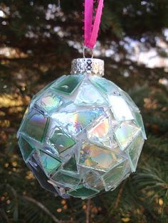 So cute and very green! Repurpose old, scratched CDs instead of throwing them out. Cut them into small pieces, then hot glue them to a plain ball ornament. Looks like a pretty, iridescent mosaic!