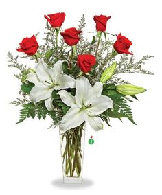 Red roses and pure white lilies are two of the most elegant blossoms in nature; combined in one lovely floral arrangement, they create double the flower power! A simple and elegant display that will m