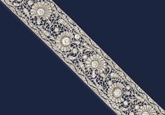 AN EARLY 20TH CENTURY DIAMOND BRACELET, BY ALFREDO RAVASCO   Of floral design, the wide band decorated with a pierced diamond-set foliate motif, mounted with six pierced flowerheads with circular-cut diamond centres to the rose-cut diamond petals, the border enhanced by a pierced wavy line, early 1920s, 23.0cm long
